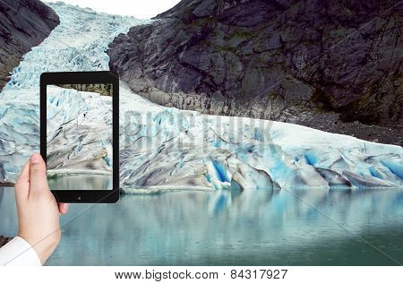 Tourist Taking Photo Of Briksdal Glacier, Norway