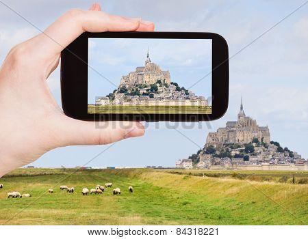 Tourist Taking Photo Of Mont Saint-michel Abbey