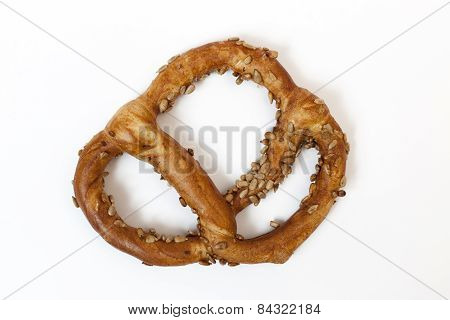 Bavarian Pretzel With Sunflowers Seeds Isolated On White Baskground