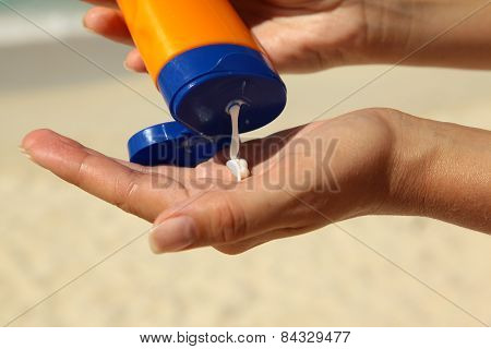 Woman Holding Sunscream