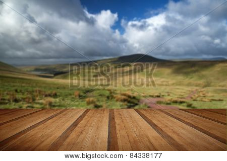 Beautiful Landscape Of Brecon Beacons National Park With Moody Sky With Wooden Planks Floor