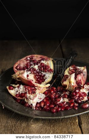 Moody Natural Lighting Images Of Fresh Juicy Pomegranate With Vintage Retro Style