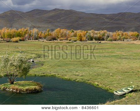 Pond In Meadow With Storm