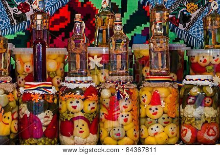 Jars With Pickles And Bottles With Alcohol