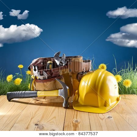 Construction Tool And Helmet On Blue Nature Background