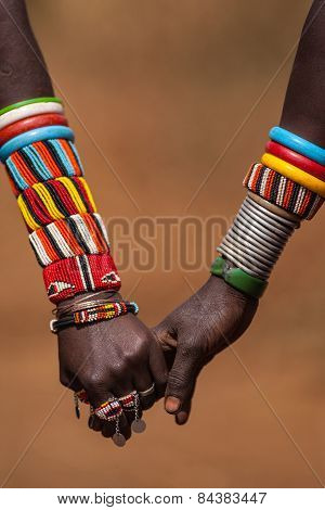 Two hands hold each other in Kenya