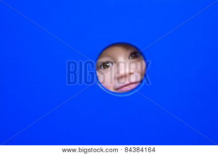 Little Kid Playing Peek-a-boo On A Playground