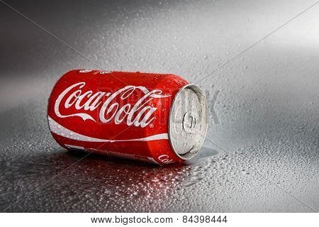SABAH, MALAYSIA - March 08, 2015: Classic Coca-Cola Can on metal background