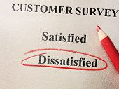 Dissatisfied circled in red circle on customer survey poster