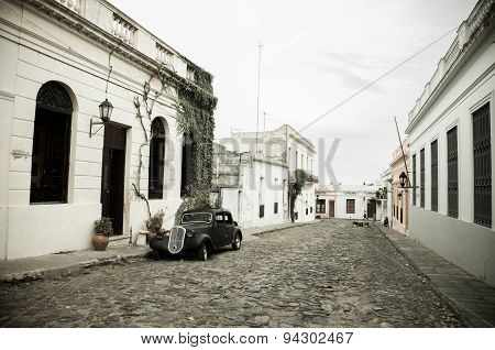 Cobblestone street with colonial houses and old car in Colonia del Sacramento, Uruguay