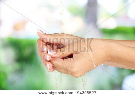 Washing hands on nature background