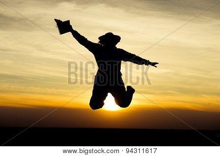 Apiarist Jumping At Susnset