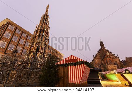 Christmas Stalls On Hauptmarkt. Schöner Brunnen Fountain And Church Of Our Lady