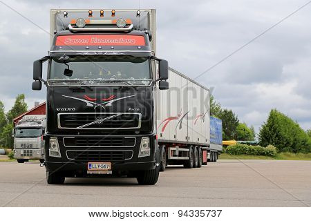Black Volvo Fh16 Leaving Truck Stop