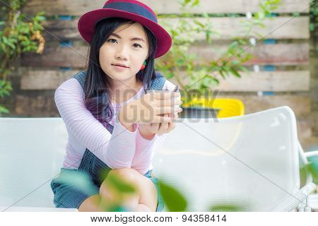 Young Business Woman With Red Hat Having A Coffee Break.