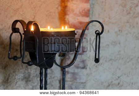 ancient iron candelabrum to illuminate the Interior of the medieval castle