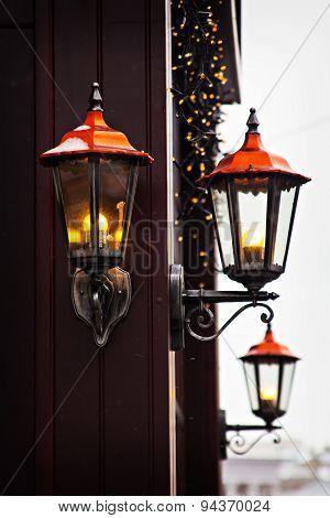 street lamp glowing in winter. glowing, urban
