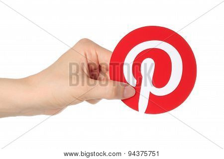 KIEV UKRAINE - APRIL 30 2015:Hand holds Pinterest logotype