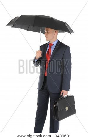 Image of a businessman with umbrella holding a briefcase. Isolated on white background poster