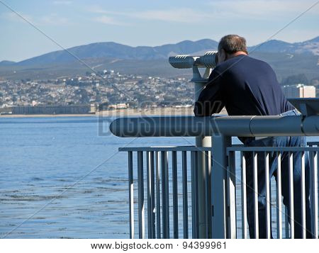 Man Exploring Ocean Through Telescope