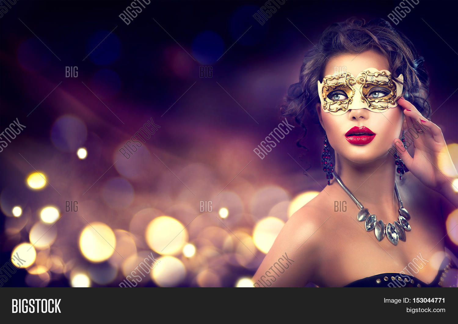 16f1f2d3c611 Beauty model woman wearing venetian masquerade carnival mask at party over  holiday dark background with magic