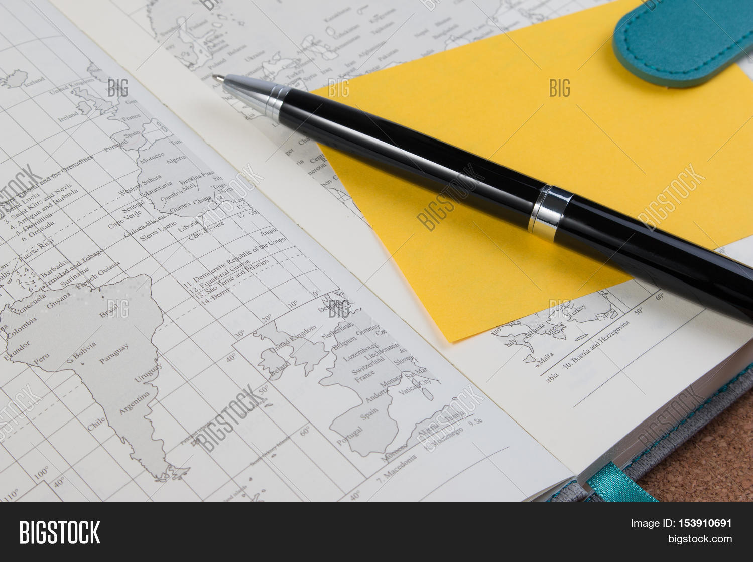 Imagen y foto world atlas business diary book bigstock world atlas business diary book with yellow paper note open business diary map book with gumiabroncs Image collections