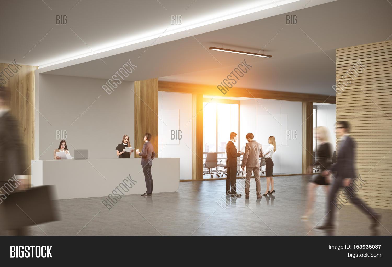 office corridor door glass. colleagues in corridor of office with reception counter and meeting room glass doors. concept door