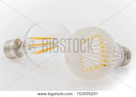 two LED bulbs with different cover plastic and glass focusing on the bulb in the foreground