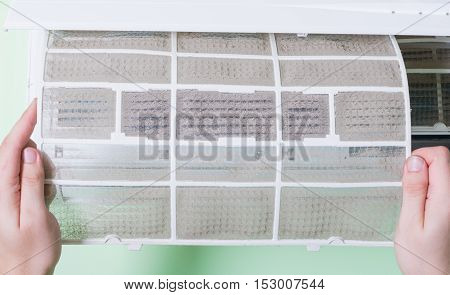 Removing dirty air conditioner filter for washing poster