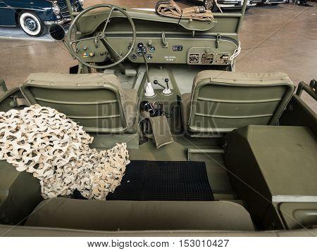 Verona Italy - May 9 2015: Dashboard of an old green military car.