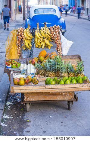 HAVANA CUBA - JULY 18 : A fruits stand in old Havana street on July 18 2016. The historic center of Havana is UNESCO World Heritage Site since 1982.