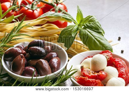 Italian food ingredients over slate.  Side view, selective focus.