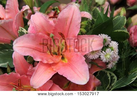 Pink tiger lily in a bridal arrangement