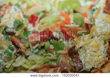 Fresh salad appetizer with crudités bacon and cream cheese