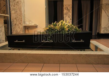 Funeral flowers on a casket funeral service