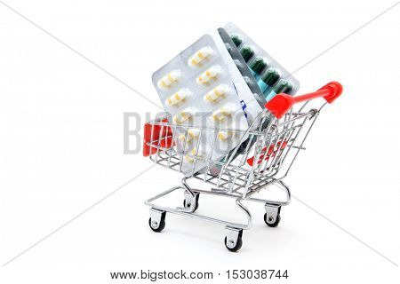 Capsules in shopping cart trolley for healthy concept