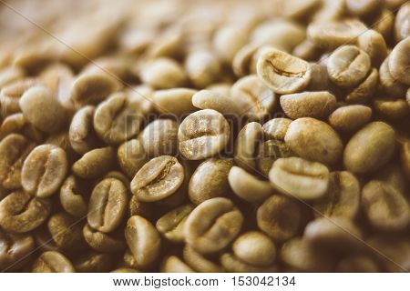 close-up of raw green coffee beans in daylight