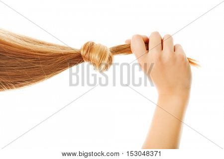 Girl with long blond human hair.