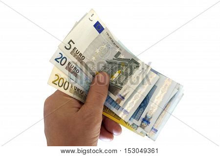 A hand holding euro banknotes isolated on white.