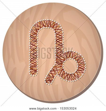 Capricorn zodiac sign in circular frame vector Illustration made in the form of filaments. Icon on a wooden background