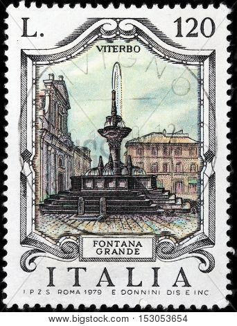 LUGA RUSSIA - JUNE 25 2016: A stamp printed by ITALY shows view of the famous Great Fountain (Fontana Grande) in Viterbo Italy circa 1979