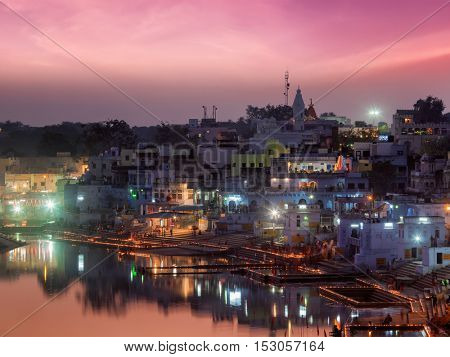 Sacred Puskhar lake (Sagar) and ghats of  town Pushkar in twilight in the evening, Rajasthan, India