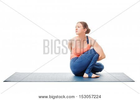 Woman doing Ashtanga Vinyasa Yoga stretching  asana Marichyasana D - pose posture dedicated to sage Marichi on white background