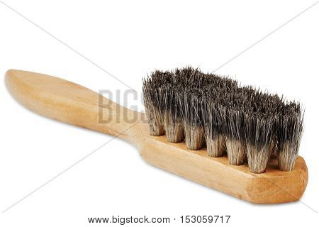 wooden brush for cleaning shoes with the bristles on isolated white background