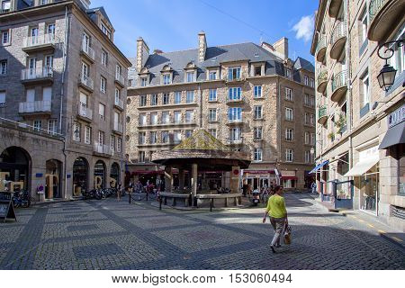 SAINT-MALO, FRANCE - CIRCA JUNE 2014: In the streets of Saint-Malo. Saint Malo is famous walled port city in Brittany in northwestern France on the English Channel.