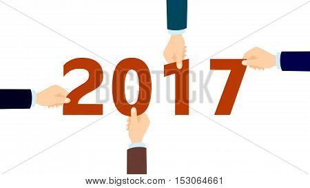 Hands with 2017. Four hands holding next year numbers. Concept of new year, future business and team building.