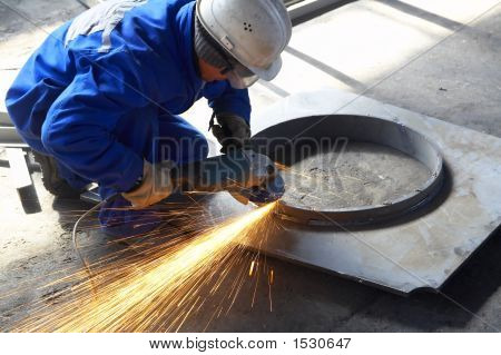 Welder With Protective Mask Welding/Finishing Metal And Sparks