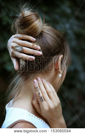 Female hands with stylish rings, closeup