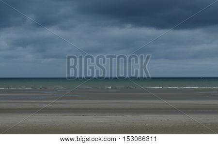 Lonely beach with a threatening looking sky (Nord sea)
