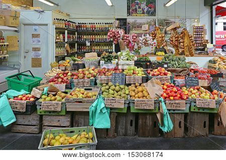 LONDON UNITED KINGDOM - NOVEMBER 20: Borough Market Stall in London on NOVEMBER 20 2013. A Variety of Fruits and Vegetables for Sale at Borough Market in London United Kingdom.
